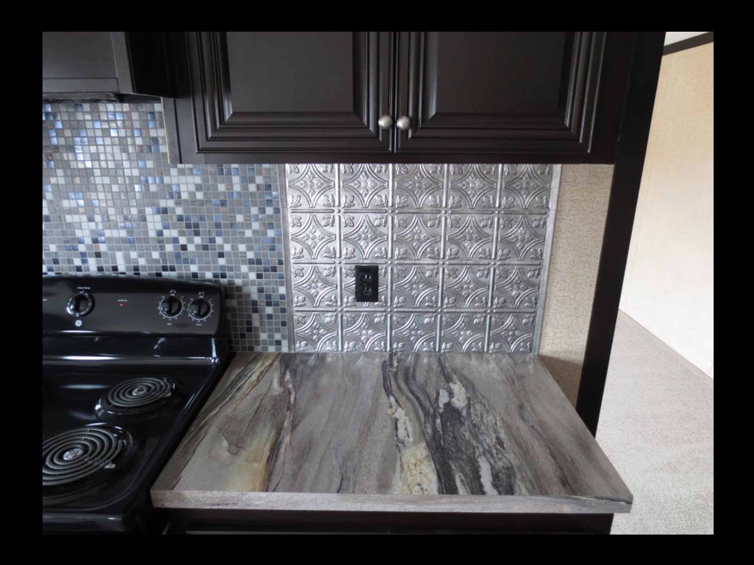 Kitchen Backsplash Ideas For Black Cabinets And Blue Storm Formica Countertops